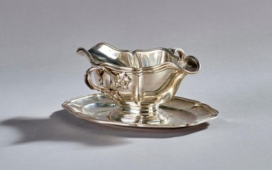 THOREL - Sauceboat and its interior in moulded silver with decoration on the handles of foliage.