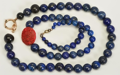 TWO SINGLE ROW LAPIS LAZULI BEAD NECKLACES, the first design...