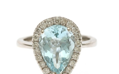 An aquamarine and diamond ring set with a pear shaped aquamarine encircled by numerous brilliant-cut diamonds, mounted in 18k white gold. Size 55.
