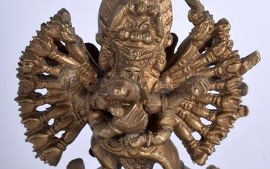 A 19TH CENTURY CHINESE TIBETAN BRONZE FIGURE OF A