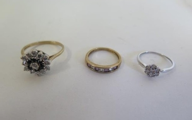 A 9ct white gold diamond cluster ring and two 9ct dress ring...