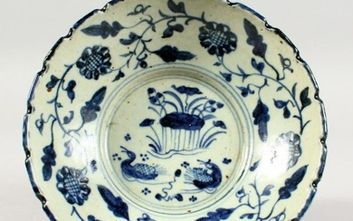 A BLUE AND WHITE POTTERY BOWL, painted with ducks and