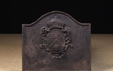 A Cast Iron Fire Back with break-arched top above a crowned armorial crest, 48 cm high, 53 cm wide (