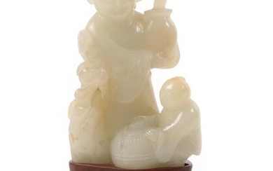 A Chinese Jade Figure Group, as a figure standing holding...