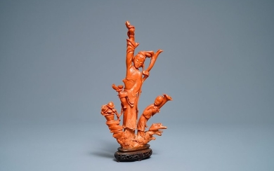 A Chinese carved red coral group of a...