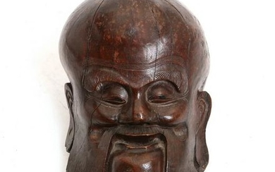 A Chinese wood head of Shou Lao