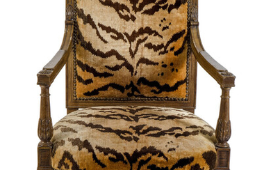 A French Empire Style Carved Mahogany Fauteuil