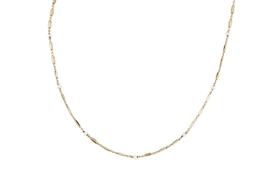 A GOLD NECKLACE SET THROUGHOUT WITH SEED PEARLS, total weigh...
