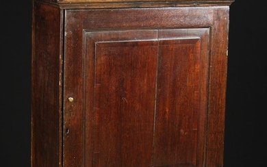 A Late 18th/Early 19th Century Oak Table Cabinet. The fielded panel door inlaid with mahogany bandin