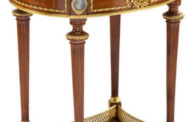 A Louis XVI-Style Gilt Bronze and Porcelain Mounted Mahogany Side Table with Marble Top
