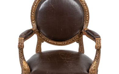 A Louis XVI Style Leather Upholstered and Parcel Gilt Fauteuil