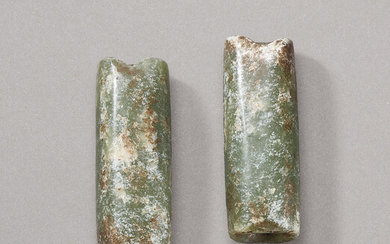 A PAIR OF MOTTLED GREEN JADE TUBULAR ORNAMENTS, NEOLITHIC PERIOD (CIRCA 6500-1700 BC)
