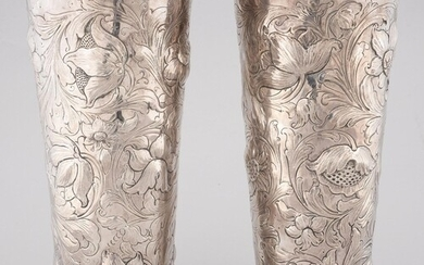 A PAIR OF SILVER REPOUSSE VASES OF TAPERED CYLINDRICAL SHAPE...