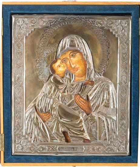 A SILVER PARCEL-GILT OKLAD OF AN ICON SHOWING THE
