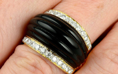 A carved onyx and diamond dress ring.
