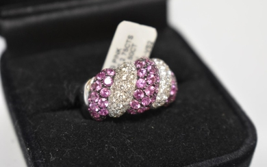 A diamond and pink sapphire white gold ring, stamped 750, se...