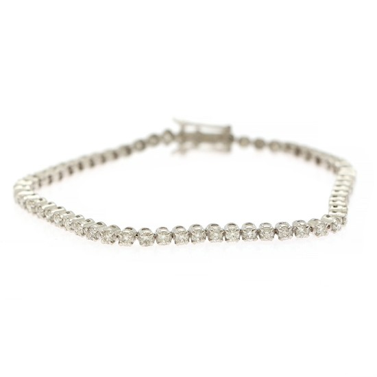 A diamond bracelet set with numerous brilliant-cut diamonds, totalling app. 2.95 ct., mounted in 14k white gold. W. 3 mm. L. 18.5 cm.
