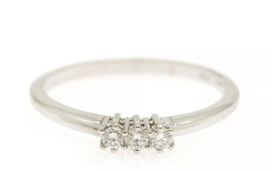 A diamond ring set with three brilliant-cut diamonds, mounted in 18k white gold. Size 54.