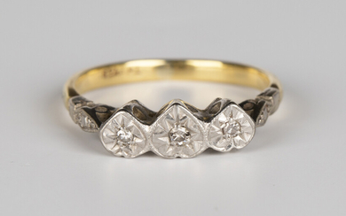 A gold and platinum ring, mounted with three circular cut diamonds in heart shaped settings, detaile