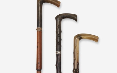 A group of three horn-mounted dagger canes Various dates...