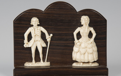 A pair of 19th century carved ivory flatback figures of a lady and gentleman, applied to a stepped r