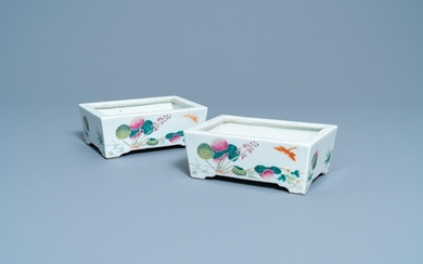 A pair of Chinese rectangular famille rose jardinieres, 19th C.
