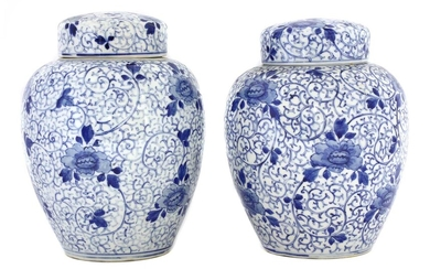 A pair of Japanese blue and white jars and covers