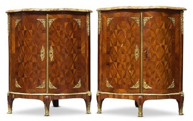 A pair of Louis XV serpentine kingwood,...