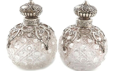 A pair of Victorian silver-mounted cut-glass scent bottles,...