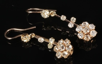 A pair of gold and diamond cluster drop earrings. Diamond we...