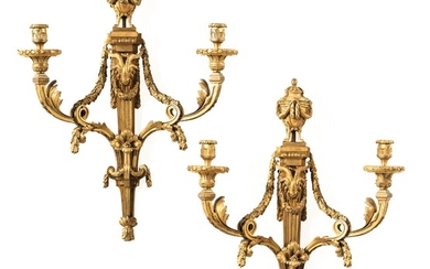 A pair of large gilt-bronze wall lights, late 18th/early 19th century, probably after a drawing by Jean-Louis Prieur