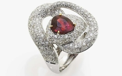 A ring with red tourmaline and brilliant cut diamonds