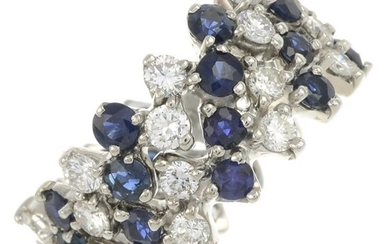 A sapphire and diamond band ring.Estimated total diamond...
