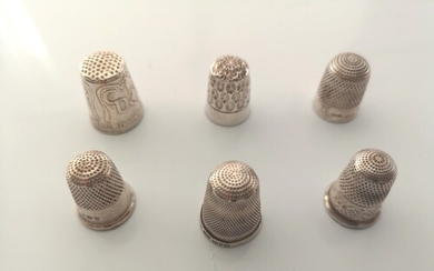 A small collection of sterling silver thimbles. Various date...