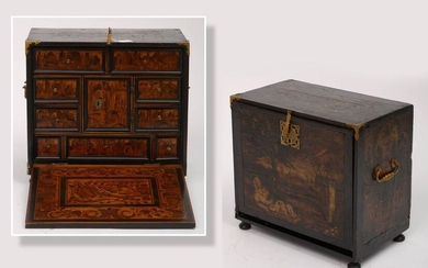 """A small travel cabinet with a blackened wooden exterior case with painted decoration, with an armour-plated side panel and a façade with the """"Virgin with the Jesse tree"""" (?). Opening by a door opening on 9 drawers and a central door in veneer and..."""