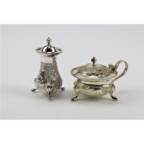 A sterling silver floral embossed Indian mustard pot & silve...