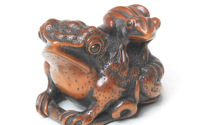 A wood netsuke of a toad and young