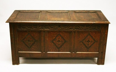 AN 18TH CENTURY OAK COFFER, with triple panelled top