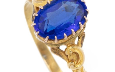 AN ANTIQUE 18CT GOLD STONE SET RING; set with an oval garnet top doublet to scrolling shoulders, size P1/2, wt. 2.7g.
