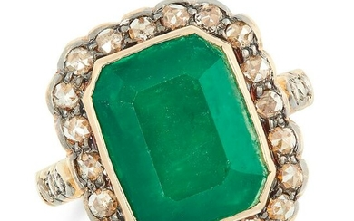 AN EMERALD AND DIAMOND CLUSTER RING set with an emerald