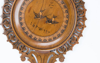 AN OLIVE WOOD MIRROR. Jerusalem, late 19th/early 20th century....