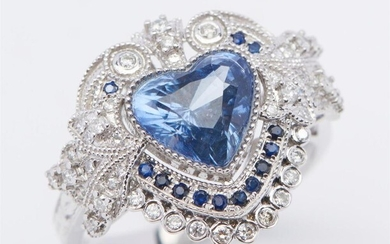 AN UNHEATED SAPPHIRE AND DIAMOND RING SET WITH A HEART SHAPED BLUE SAPPHIRE OF 2.49CTS, WITHIN A DECORATIVE SURROUND DETAILED WITH S...