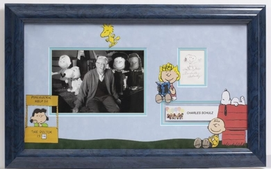 CHARLES SCHULZ SIGNED SNOOPY CARTOON with a photograph of...