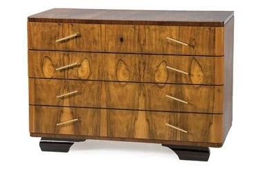 Chest of drawers in walnut root, with legs in ebonized