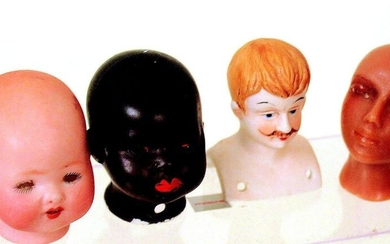 Group of poured bisque small doll heads including...