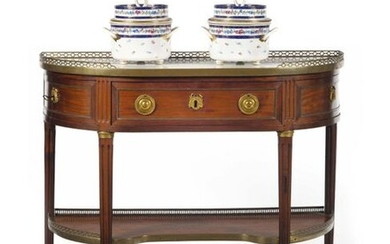 Moulded mahogany console table with brass rods, opening to one drawer and two side leaves, the white marble top with gallery resting on tapered fluted uprights joined by a spacer shelf, (accidentals). Stamp of Claude Mathieu Magnien, cabinetmaker...