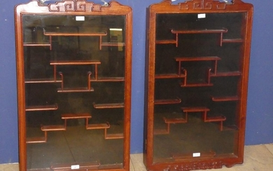 Pair of Chinese snuff bottle cabinets with extensive shelvin...