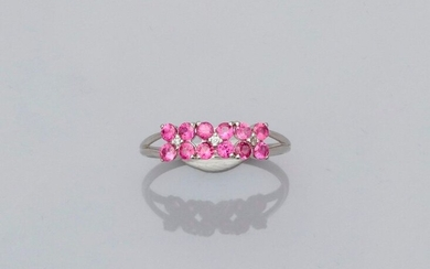 Ring in white gold, 750 MM, motif covered with round rubies interspersed with three diamonds, size: 53, weight: 1.8gr. rough.