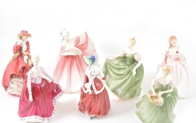 Seven Royal Doulton figurines.