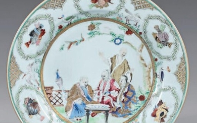 Small porcelain dish. Qianlong, 18th century, circa 1736-1740, decorated with enamels of the Rose Family, in the center of many figures in a landscape in a gold medallion, the wing with fish and various animals in interspersed green cartouches, green...
